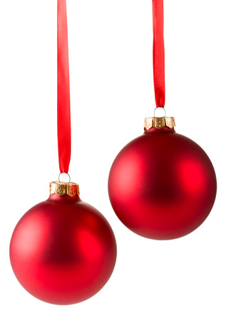 two red christmas balls hanging on ribbon isolated on white