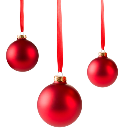 red christmas balls hanging on ribbon