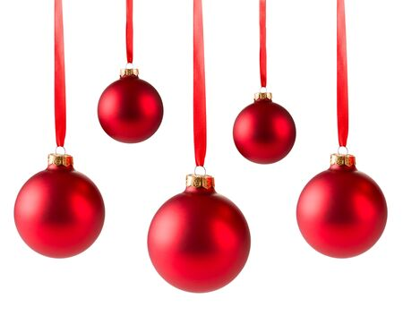 five red christmas balls hanging on ribbon isolated on white