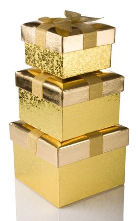 stack of golden gift boxes isolated on white background Stock Photo