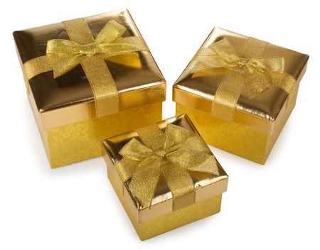 Three golden gift boxes isolated on white background