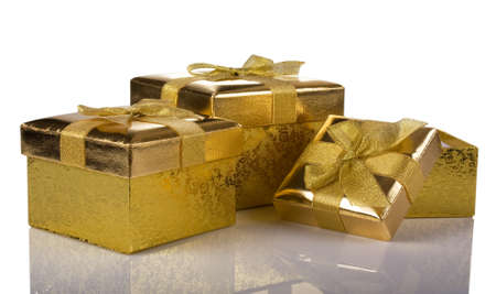 Christmas gift golden three boxes isolated on white background Stock Photo