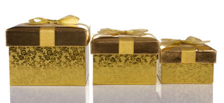 Christmas gift golden boxes isolated on white background