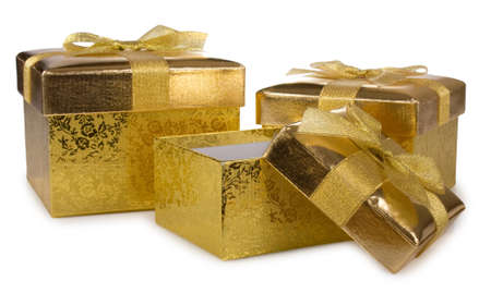 Gift golden boxes isolated on white background Stock Photo