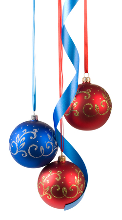 christmas balls hanging on ribbons isolated on white background