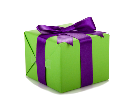 green and purple: green gift box with purple ribbon and bow Stock Photo