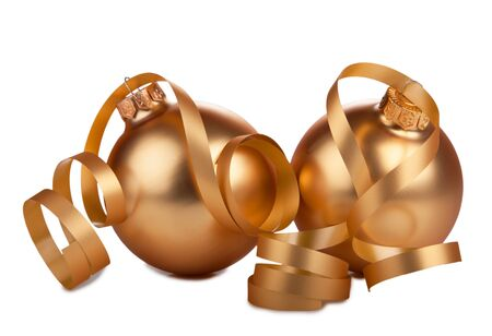 Golden christmas balls and ribbon isolated on white background