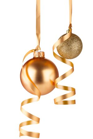Golden christmas balls hanging isolated on white background Stock Photo