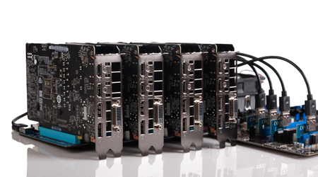 Four graphic cards are connected to the motherboard via risers card