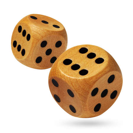 dice: Pair of wooden dices being rolled head on in a game of chance and isolated against a white background Stock Photo