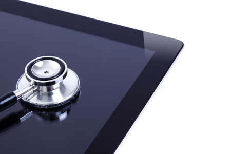 solated: Digital touch screen tablet with dual head high quality stethoscope, focus on stethoscope and solated on white background