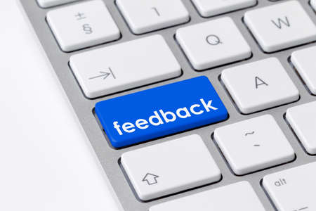 e survey: Keyboard with one blue button with the word feedback