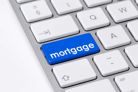 Keyboard with one blue button with the word mortgage photo