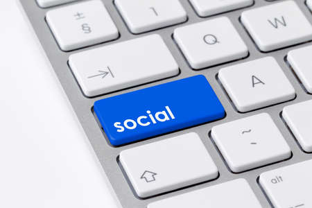 Keyboard with single blue button showing the word social photo