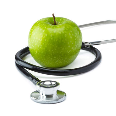 Green Apple Granny Smith with medical stethoscope isolated on white background for healthy eating photo