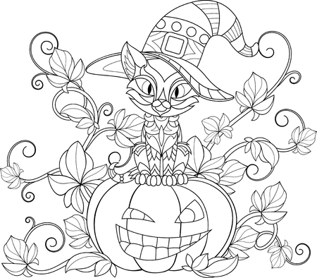 Funny feline in a witch hat sits on a pumpkin