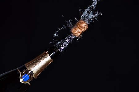 popping cork: Close-up of champagne explosion