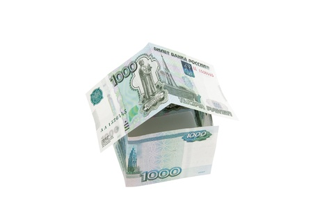 money in the form of house on a white background Banque d'images
