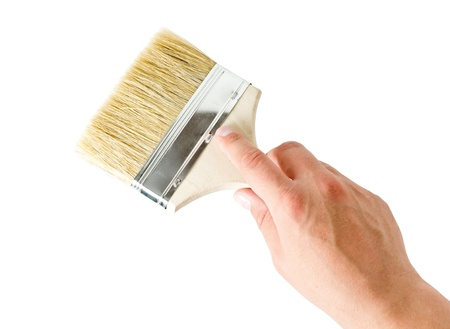 hand holding a brush isolated on a white background
