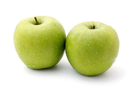 two ripe green apples isolated on a white background