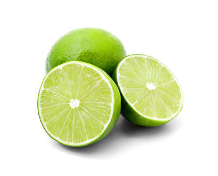 Two halves of lime and one whole lime isolated on white Banque d'images