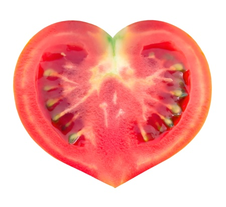 tomato in the shape of heart isolated on white background