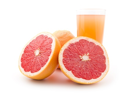 Ripe grapefruit and a glass of juice isolated on white background photo