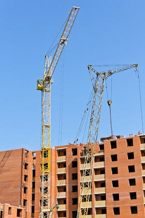 construction of an apartment building with a crane photo