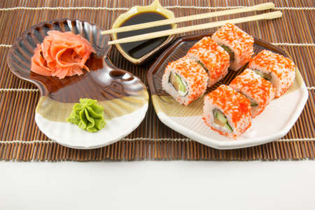 wasabi: Japanese seafood sushi rolls with chopstick wasabi and ginger background Stock Photo