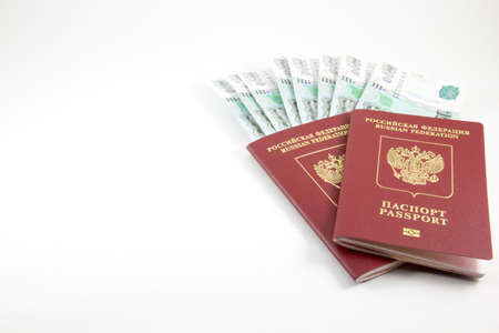 the federation: The passports of the Russian Federation and money on a white background