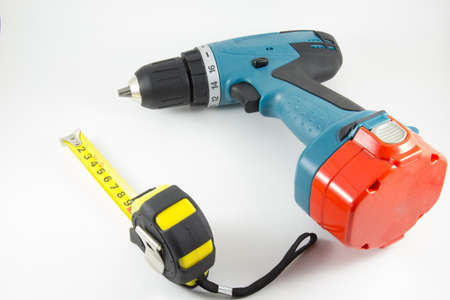 cordless: Cordless screwdriver and a tape measure