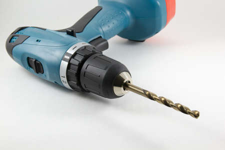 cordless: Cordless screwdriver with a drill on a white background