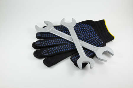 white work: Wrenches work gloves on a white background