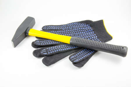 fiberglass handle: Hammer and work gloves on a white background