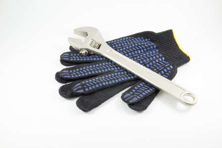 white work: Wrench and work gloves on a white background Stock Photo