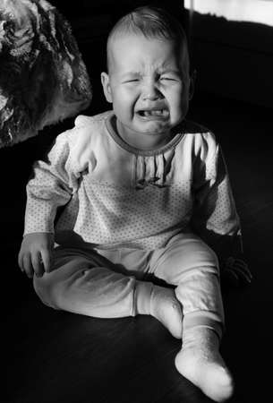 cries: Portrait of a crying baby. The baby cries
