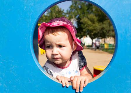 Portrait of a sad little baby