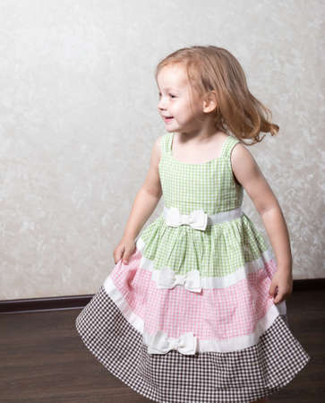 Cute little girl dancing, spinning in a dance, laughing