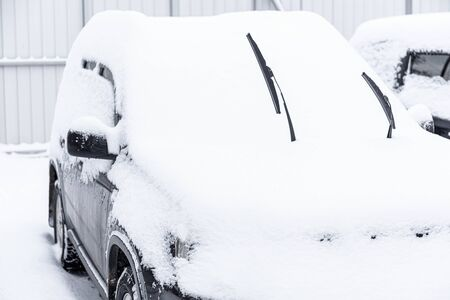 Car standing in snow. Snowdrift of snow by car. Snow covered car. Winter, snow, car in snowdrift.