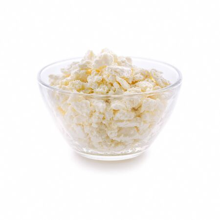 Plate with fresh cottage cheese on a white background. Very useful dairy product for the development of the child's body.