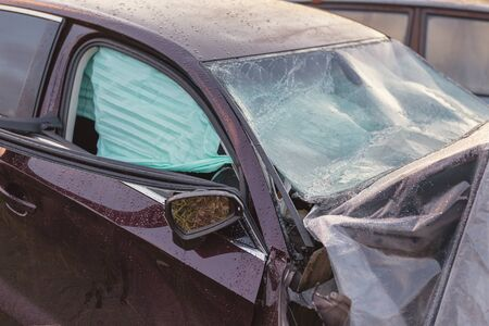 The broken field of a head-on collision car, with airbags deployed.