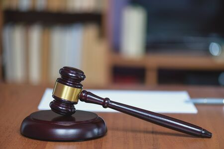 Justice and law concept. Wooden hammer of the judge. Court and decision. Judge hammer on the wooden table. Judge pronounced the sentence. Judicial justice and law. Stock Photo