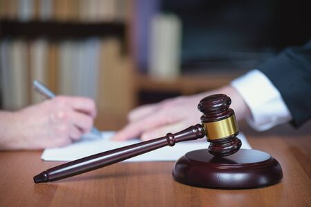 Law and order. Signing legal agreement. Court, courtroom, law. Stock Photo