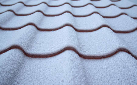 icey: Roof from a metal tile covered by hoarfrost Stock Photo