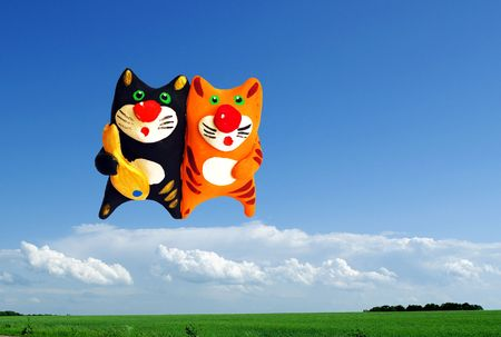 royalty free: Two cats in the sky with fish