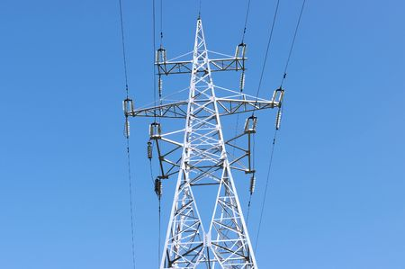Electric high voltage post with blue sky background  photo