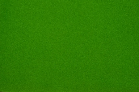 scenical: Texture of dense cardboard with green velvety  coating
