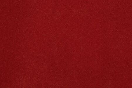 scenical: Texture of dense cardboard with vinous velvety  coating
