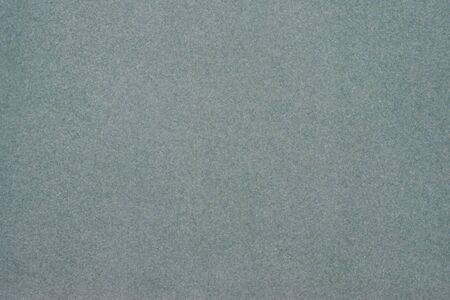scenical: Texture of dense cardboard with grey velvety  coating