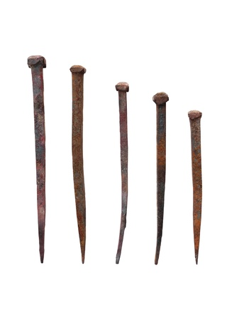 the spike: Old forged nails with rusty isolated on white background Stock Photo